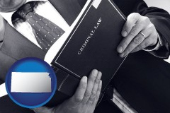 ks map icon and an attorney reading a criminal law book