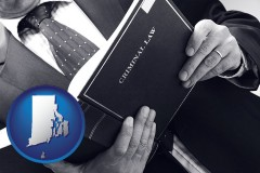 rhode-island map icon and an attorney reading a criminal law book