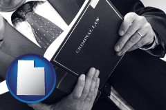 utah map icon and an attorney reading a criminal law book