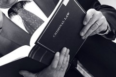 an attorney reading a criminal law book