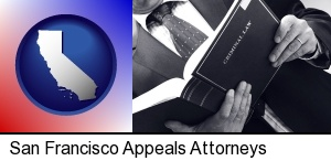 an attorney reading a criminal law book in San Francisco, CA